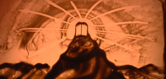 """אהרן זאב ברנשטיין ממחיש את """"מתן תורה"""" בציור חול 3"""
